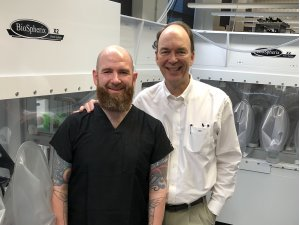 Drs. Ed Stone and Budd Tucker in front of the BioSpherix units